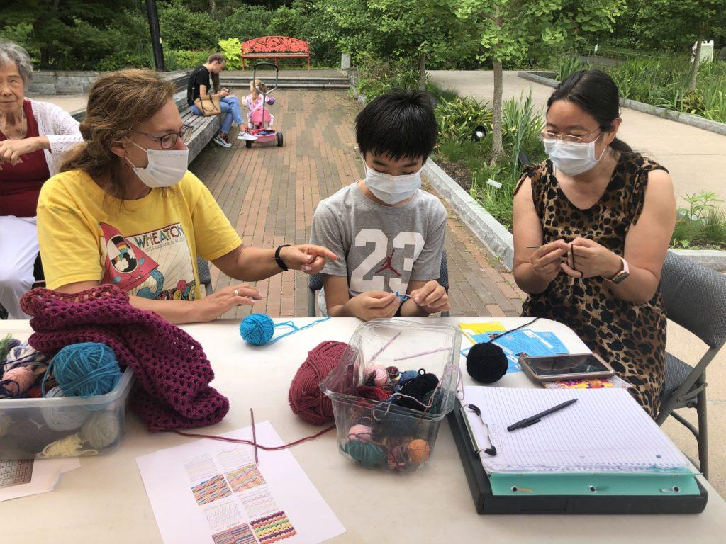 Felisa Federman, co-lead artist, shares her crochet expertise at Brookside Gardens
